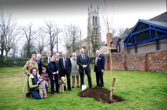 Members of the Woodward and Brinton Families plant a tree during the visit by HRH The Duke of Kent to St. George's Park, Kidderminster